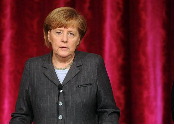 German Chancellor Angela Merkel speaks during a joint press conference with French President Francois Hollande.