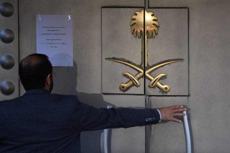 A Saudi official opens the door of the Saudi Arabian consulate on Monday in Istanbul.