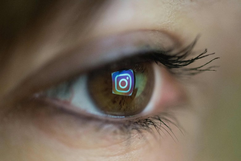 The Instagram logo is reflected in someone's eye.