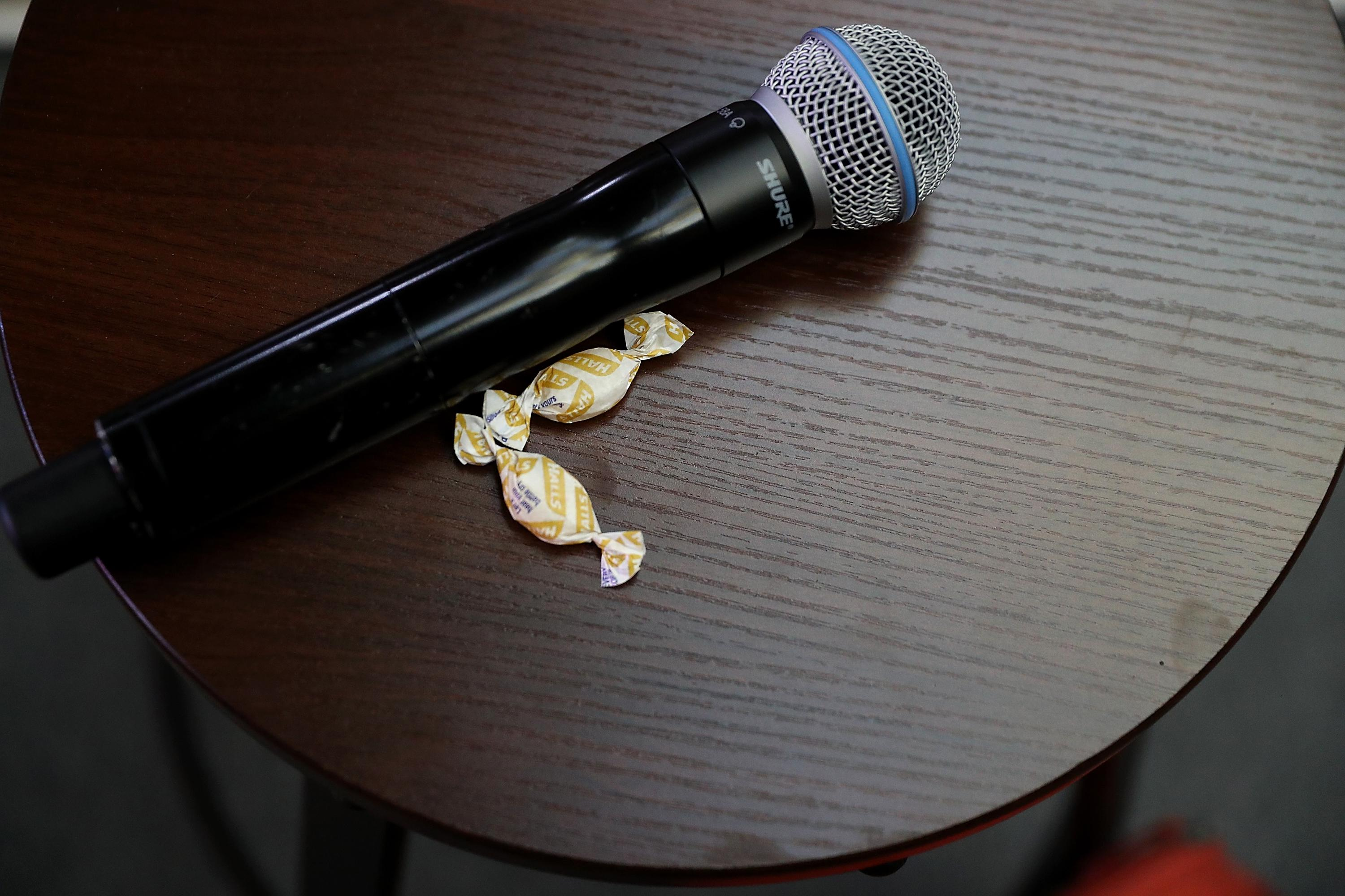 Microphone and cough drops on a table.