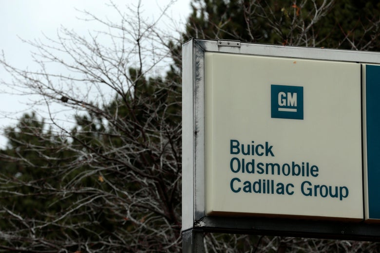 A sign that included Oldsmobile, hangs outside the Detroit-Hamtramck Assembly as General Motors announced the closing of multiple facilities including the on November 26, 2018 in Detroit. - In a massive restructuring, US auto giant General Motors announced Monday it would cut 15 percent of its workforce to save $6 billion and adapt to 'changing market conditions.' The moves include shuttering seven plants worldwide as the company responds to changing customer preferences and focuses on popular trucks and SUVs and increasingly on electric models.GM will shutter three North American auto assembly plants next year: the Oshawa plan in Ontario, Canada; Hamtramck in Detroit, Michigan and Lordstown in Warren, Ohio.In addition, it will close propulsion plants -- which produce batteries and transmissions -- in Baltimore, Maryland and Warren, Michigan, as well two more unidentified plants outside of North America. (Photo by JEFF KOWALSKY / AFP)        (Photo credit should read JEFF KOWALSKY/AFP/Getty Images)