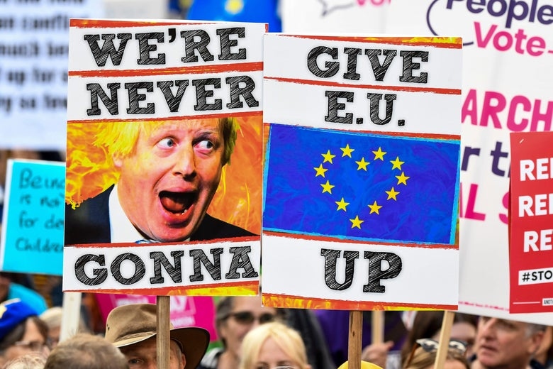 Demonstrators hold placards and EU and Union flags as they take part in a march by the People's Vote organization in central London on October 19, 2019, calling for a final say in a second referendum on Brexit.