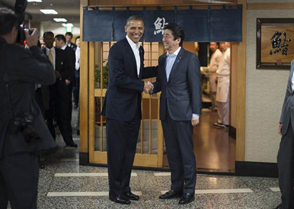 President Obama (L) shakes hands with Japanese Prime Minister Shinzo Abe.