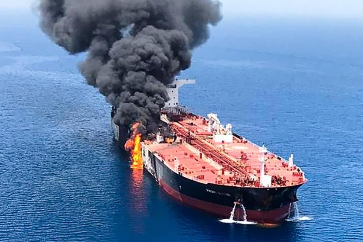 Fire and smoke billowing from a tanker.