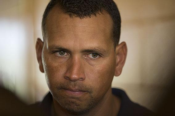 New York Yankees' Alex Rodriguez talks with reporters outside the Lakeland Flying Tigers visitor's clubhouse after reporting for his rehab assignment with the Tampa Yankees in Lakeland, Florida July 5, 2013.