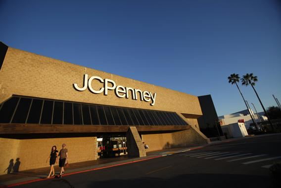 A couple walks by a J.C. Penney store in Arcadia, California March 1, 2013.