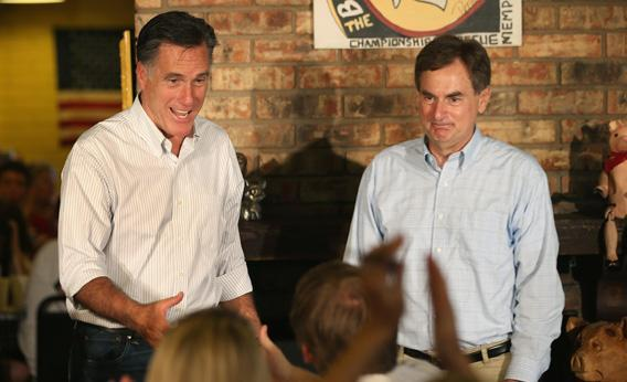 Mitt Romney, left, and Senate candidate Richard Mourdock, right, greet supporters at a campaign event.
