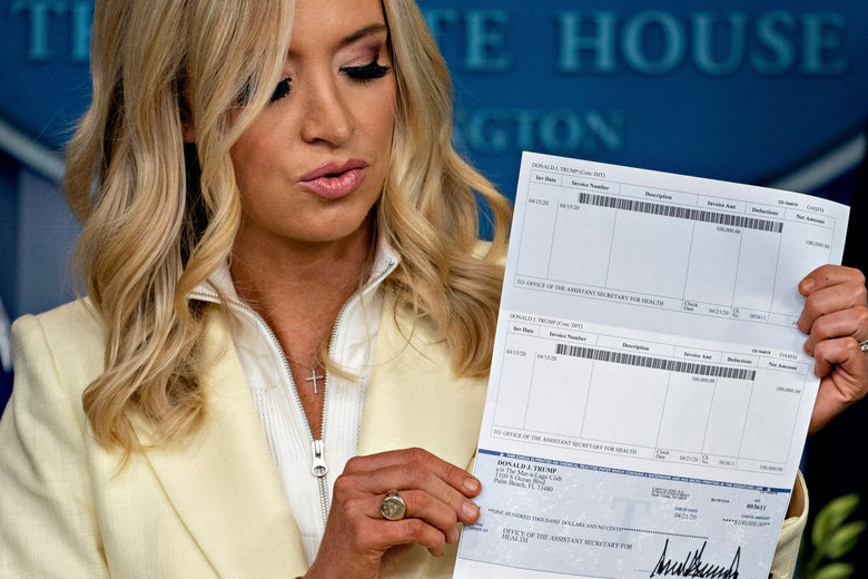 Kayleigh McEnany, White House press secretary, holds a check, in the amount of President Donald Trump's salary, to be donated to the Department of Health and Human Services (HHS) during a news conference in the Brady Press Briefing Room of the White House in Washington, D.C., U.S., on May 22, 2020.