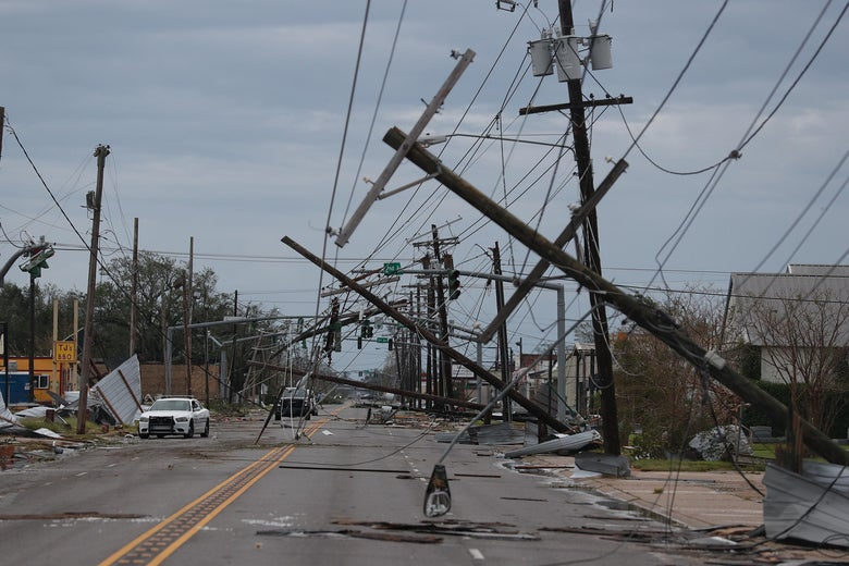 A street is seen strewn with debris and downed power lines.