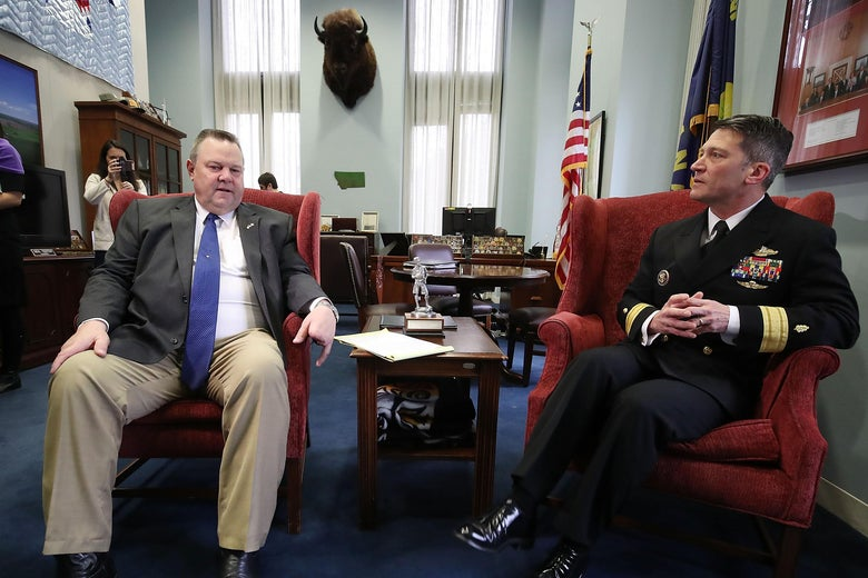 WASHINGTON, DC - APRIL 17: Physician to the President U.S. Navy Rear Admiral Ronny Jackson meets with Sen. Jon Tester (D-MT) in his office in the Hart Senate Office Building on Capitol Hill April 16, 2018 in Washington, DC. President Donald Trump nominated Jackson, his personal doctor at the White House, to be the new Secretary of the Department of Veterans Affairs after Trump fired David Shulkin on March 28.   (Photo by Mark Wilson/Getty Images)