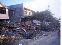 Shops and homes are reduced to rubble and debris