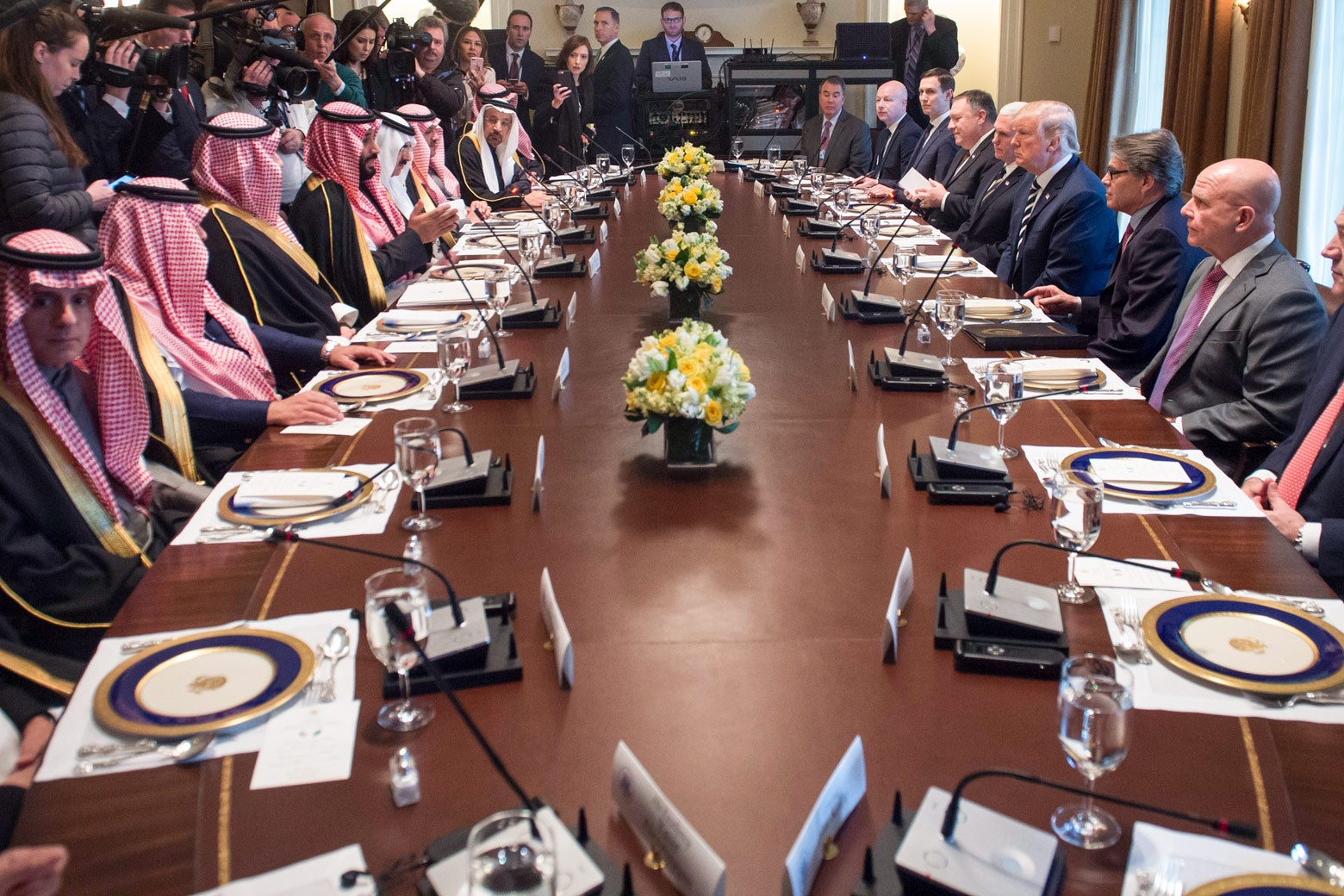 The Saudi delegation seated on one side of a long conference table, Trump and his aides on the other.
