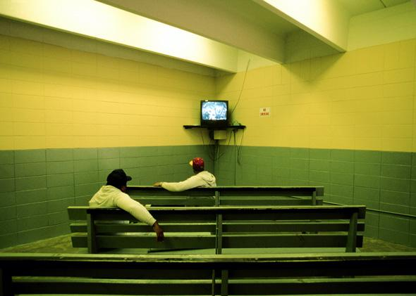 "Two men watch television in the Angola State Penitentiary, where a majority of inmates are ""lifers"" (Prisoners for the rest of their life) on April 01, 2002 in Angola, Louisiana."