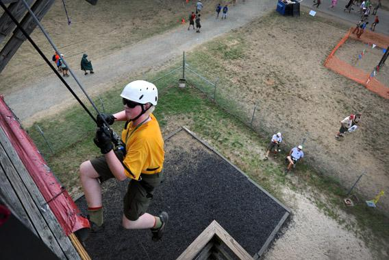 A Boy Scout makes his way down a rappelling wall on July 29, 2010 during the National Scout Jamboree in Virginia