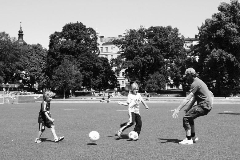 A family enjoys a game of soccer together in Vasaparken.
