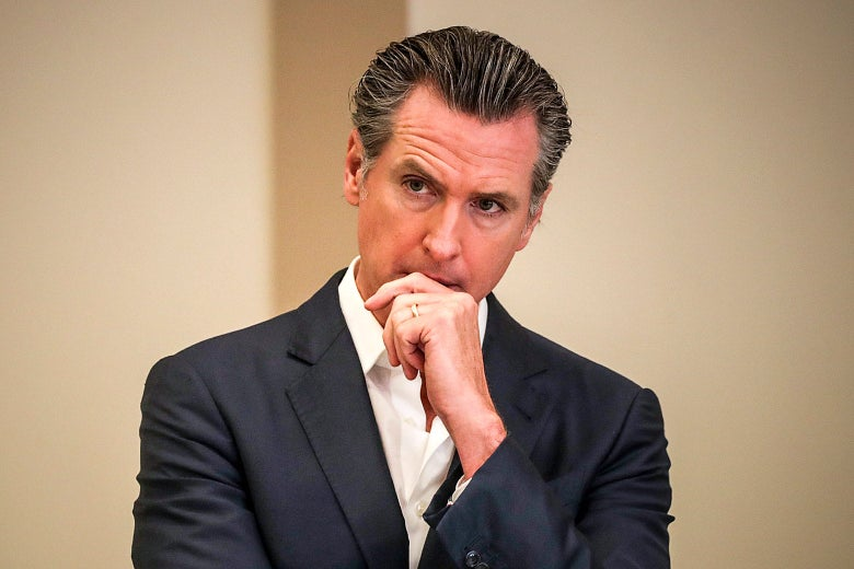 Gov. Gavin Newsom standing with a pensive expression.