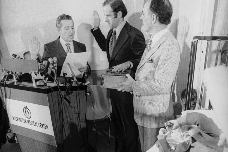 Sen. Joseph Biden takes the oath of office from U.S. Senate secretary Frank Valeo in 1973. His father-in-law, Robert Hunter, and son Joseph Beau Biden are at his side in Beau's hospital room.