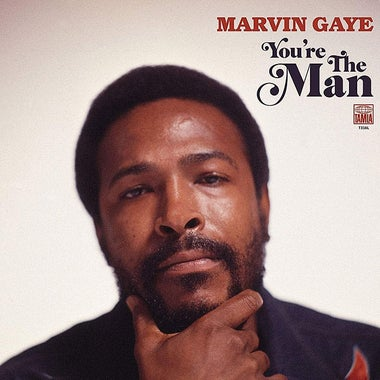 Album cover: Marvin Gaye stares directly into the camera with a pensive look on his face while framing his chin with his thumb and index finger.