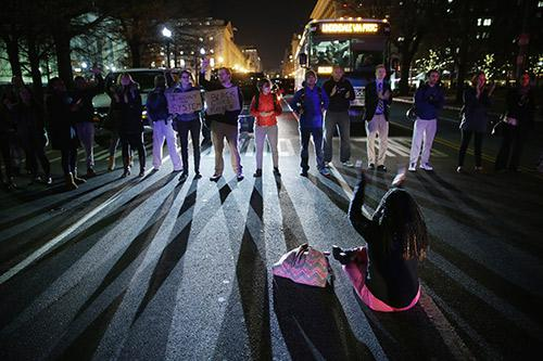 Demonstrators block traffic at 15th Street and Pennsylvania Avenue, NW, during a protest against a New York grand jury decision December 3, 2014 in Washington, DC.