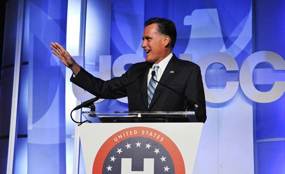 Mitt Romney waves to one of his sons and grandsons before addressing the US Hispanic Chamber of Commerce.