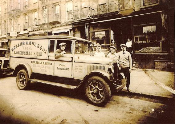 The Harlem Macaroni Co.'s delivery truck around 1934. Company owner Giorgio Cataudella is seen third from left.