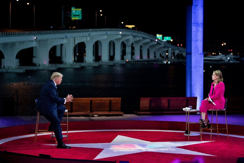 Trump speaks as he and Guthrie sit across from each other on an open-air stage, with water and a bridge in the background