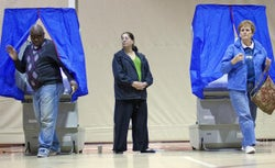 Voters leave voting booths after casting ballots