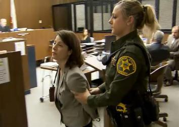 Patricia Esparza with an Orange County, Calif., police officer after rejecting a plea deal on Nov. 22, 2013.