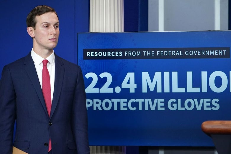 Kushner stands beside a video screen displaying a graphic which claims the federal government has shipped 22.4 million protective gloves.