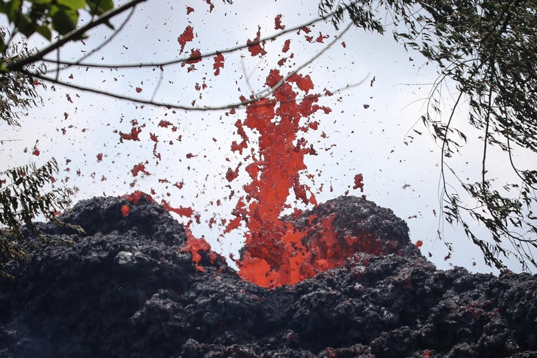 A lava fissure erupts in the aftermath of eruptions from the Kilauea volcano on Hawaii's Big Island, on May 12, 2018 in Pahoa, Hawaii.