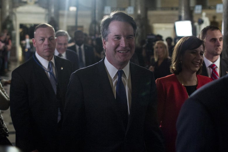 Kavanaugh smiling as he and others file into the House chamber.