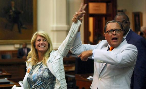 State Sen. Jose Rodriguez (D-El Paso) (R) celebrates with State Sen. Wendy Davis (D-Ft. Worth) (3L) as the Democrats defeat the anti-abortion bill SB5.