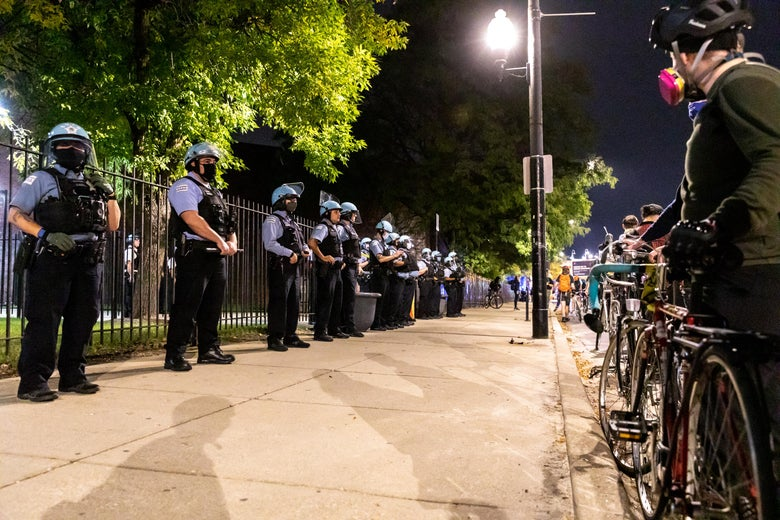 Chicago Police lined the sidewalks during a demonstration on September 23, 2020 in Chicago, Illinois. Across the country, protesters have taken to the streets after the grand jury's decision to only charge one Louisville Metro Police officer in the raid in which Taylor was killed. Officer Brett Hankison, who was fired in June, was charged three counts of wanton endangerment for shooting into neighboring apartments. Bond was set at $15,000 for Hankison. Taylor, a 26-year-old emergency medical technician, was killed in her home during a no-knock raid on March 13, 2020. (Photo by Natasha Moustache/Getty Images)