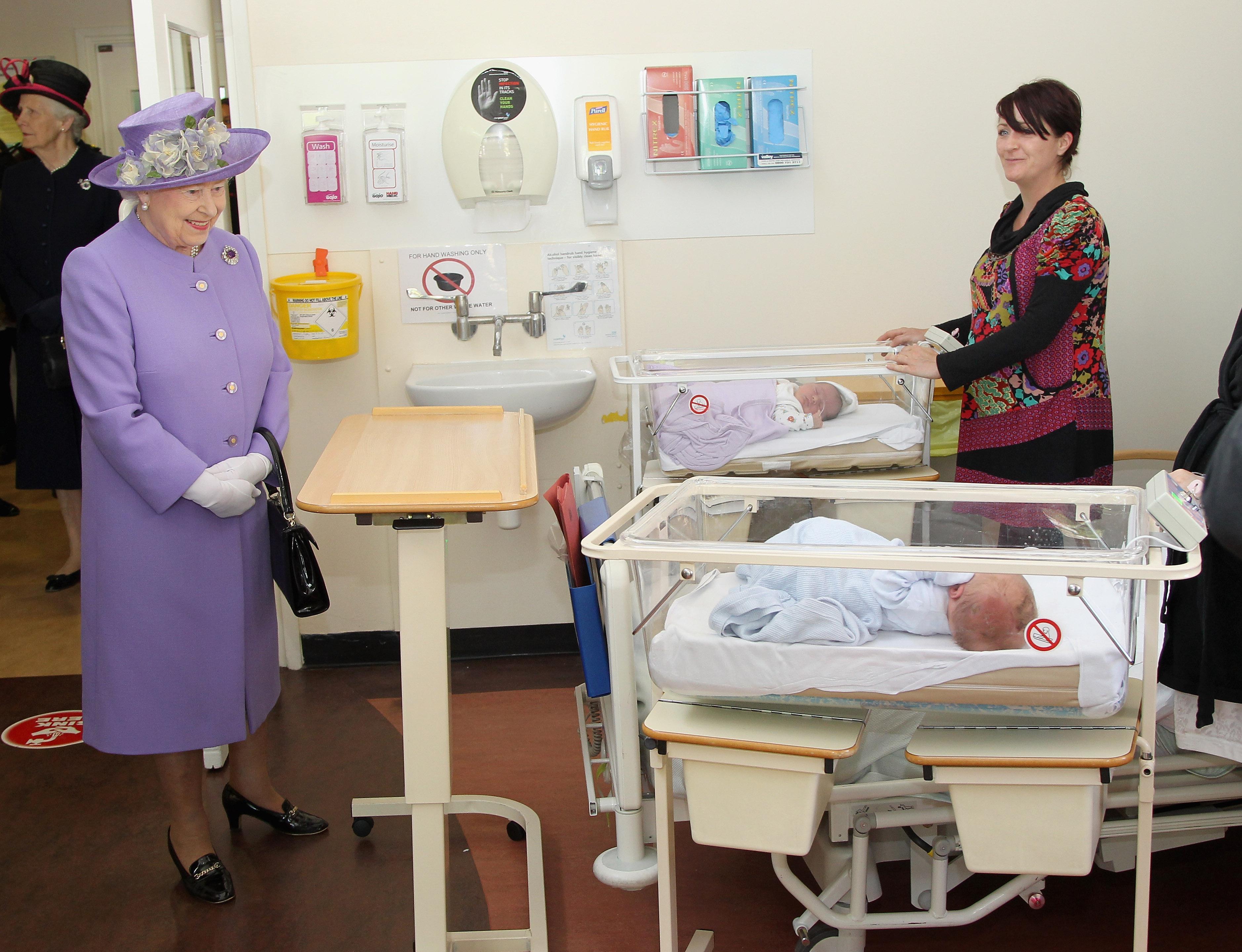 Queen visits babies.