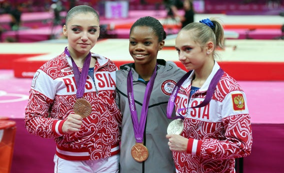 Aliya Mustafina, Gabby Douglas, and Viktoria Komova