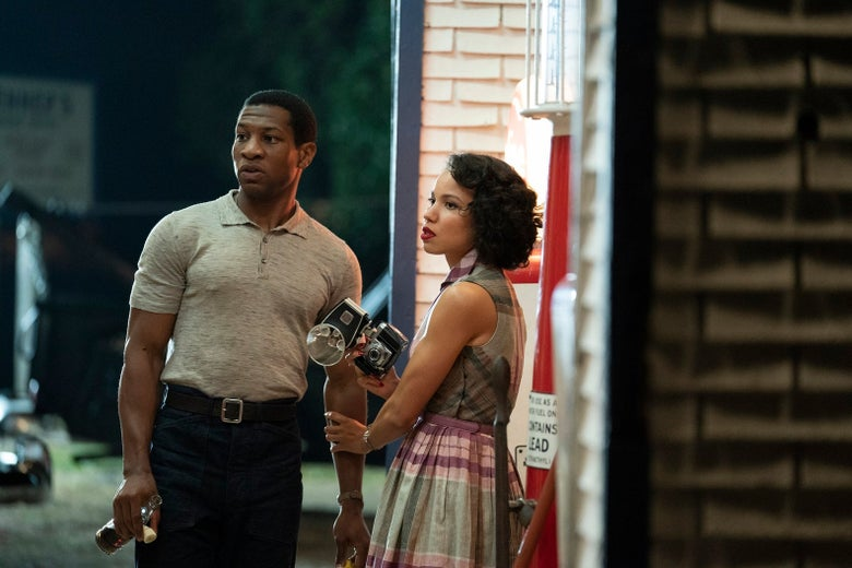 In a still from the show, Majors and Smollett look handsome, stylish, and afraid, at night at a roadside stop. Smollett is holding a camera.