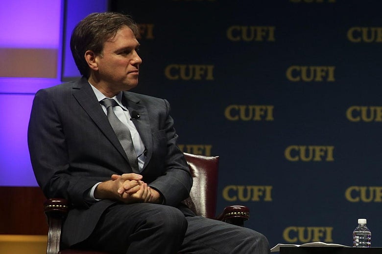 New York Times opinion columnist Bret Stephens looks to his left.
