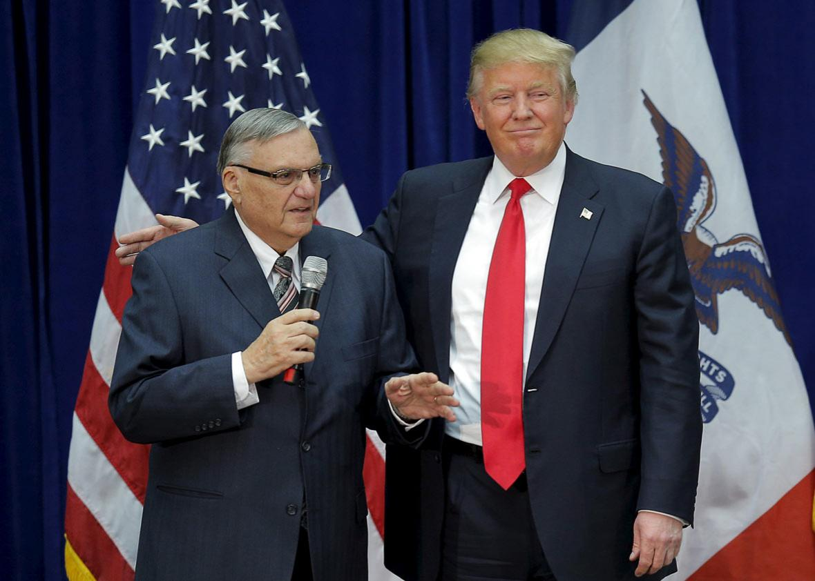 U.S. Republican presidential candidate Donald Trump is joined onstage by Maricopa County Sheriff Joe Arpaio