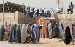 Burqa-clad female supporters of Afghan President Hamid Karzai arrive at an election gathering in Kandahar. Click image to expand.
