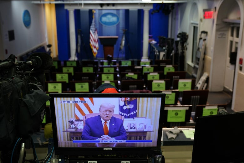 An image on a monitor shows President Donald Trump speaking during in a video posted on the White House Twitter feed, in the empty Brady Briefing Room of the White House in Washington, D.C. on January 13, 2021.