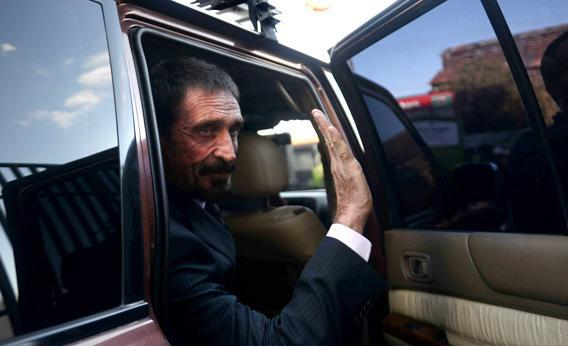 US anti-virus software pioneer John McAfee waves to journalists while leaving, in front of the Supreme Court in Guatemala.
