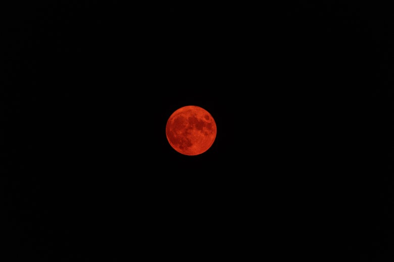 The moon glows burnt orange behind thick wildfire smoke on July 23, 2021 in Blush, Oregon.