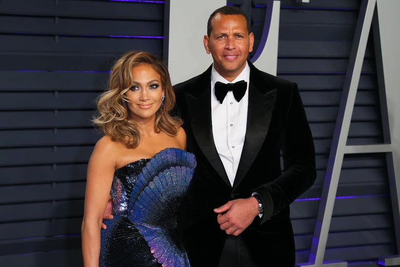 Jennifer Lopez and Alex Rodriguez on a red carpet.