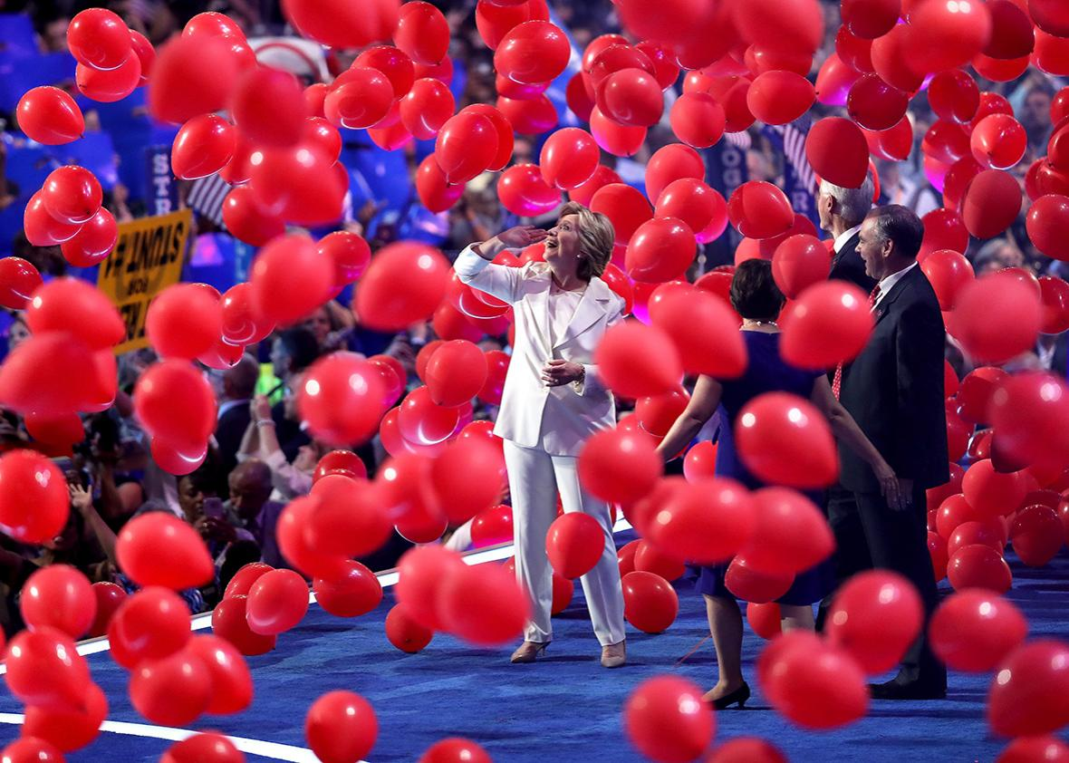 Democratic presidential candidate Hillary Clinton watches balloons drop at the end of the fourth day of the Democratic National Convention at the Wells Fargo Center, July 28, 2016 in Philadelphia, Pennsylvania.