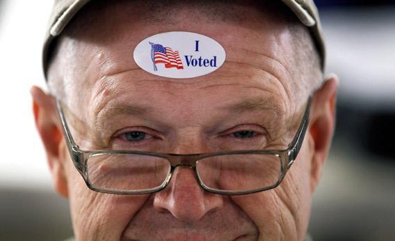 John Vandermark wears his ' I Voted' sticker after voting.