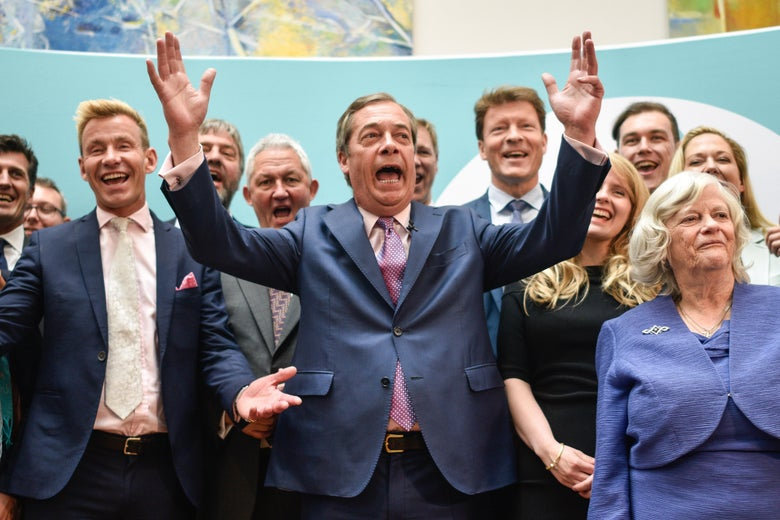 Brexit Party leader Nigel Farage speaks to the media as he stands with newly elected Brexit Party MEPs, including Dr David Bull (L) and Ann Widdecombe (R) at a Brexit Party event on May 27, 2019 in London, England.