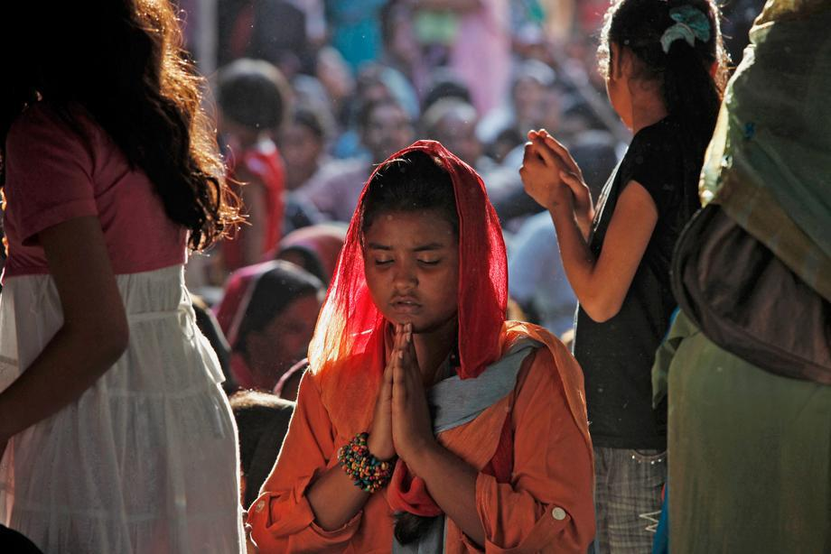 A Pakistani Christian woman prays during a Good Friday service at the Saint Anthony Church in Lahore March 29, 2013.