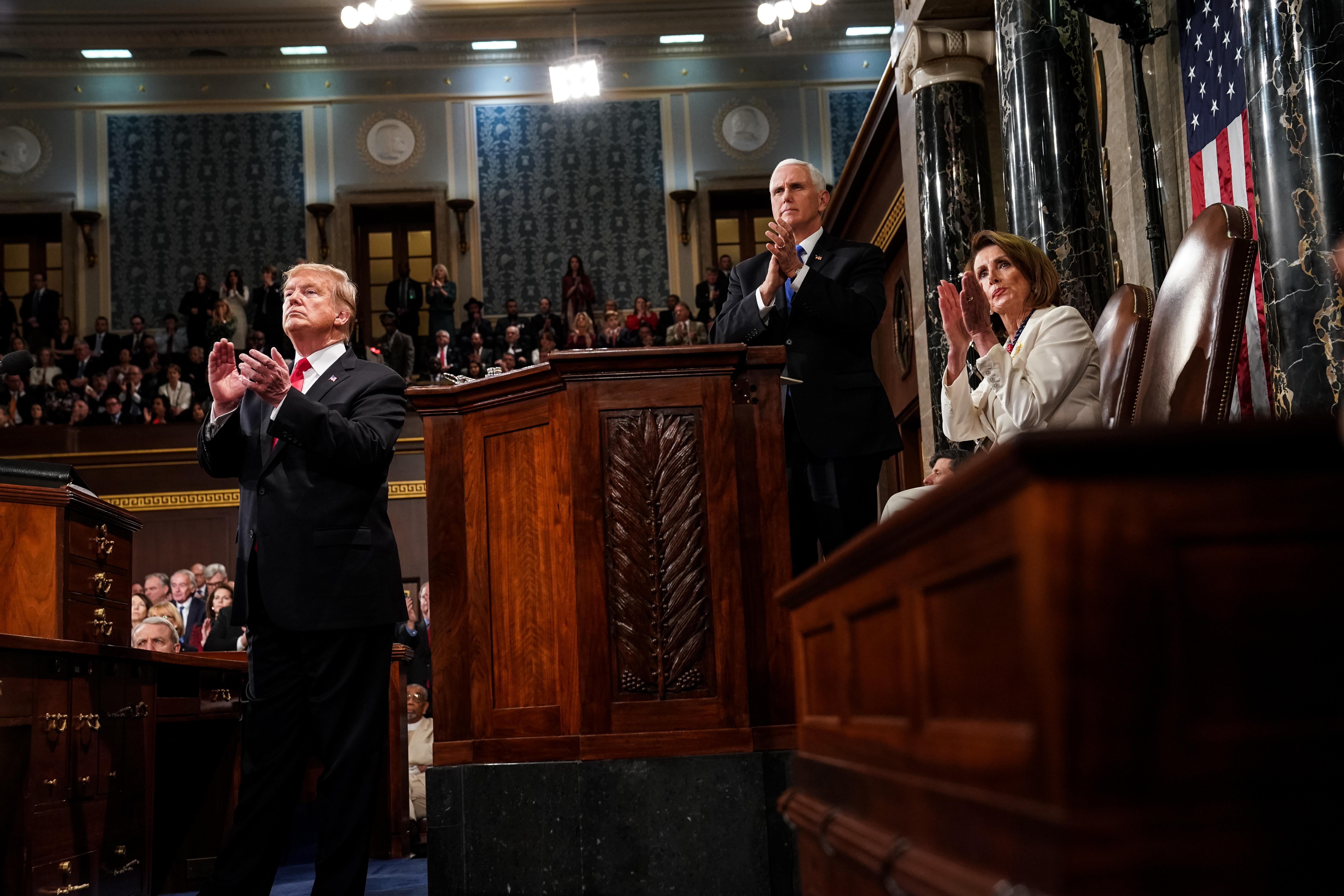 U.S. President Donald Trump, House Speaker Nancy Pelosi, and Vice President Mike Pence applaud during the State of the Union address on Tuesday in Washington.