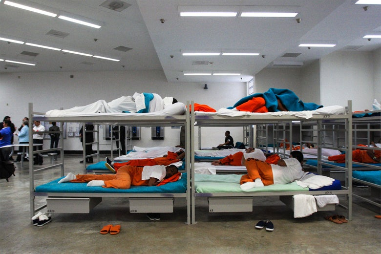 Male detainees sleep on their bunks in the dormitory of the Alpha Unit at Port Isabel detention facility in Texas, United States on December 17, 2008.