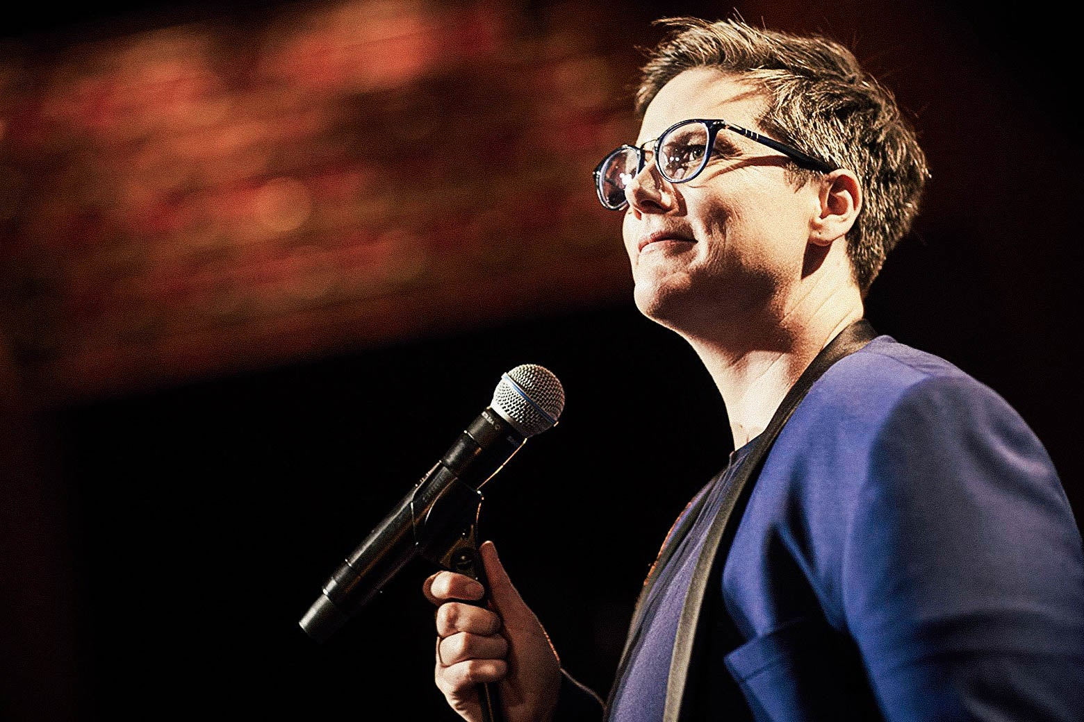 Hannah Gadsby at a microphone.